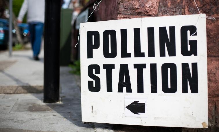 Close up of UK polling station street sign