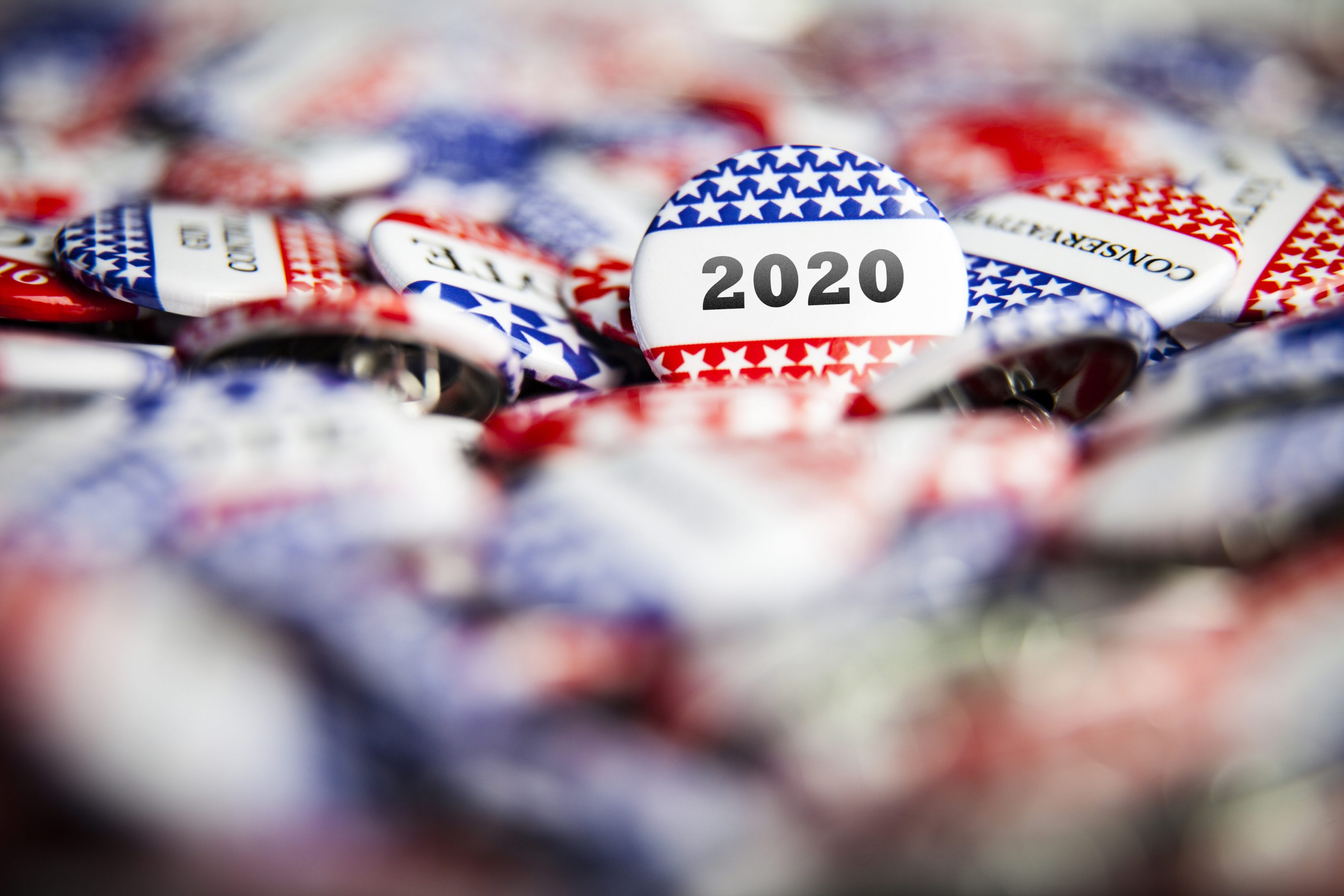 Closeup of election vote buttons with text that says 2020
