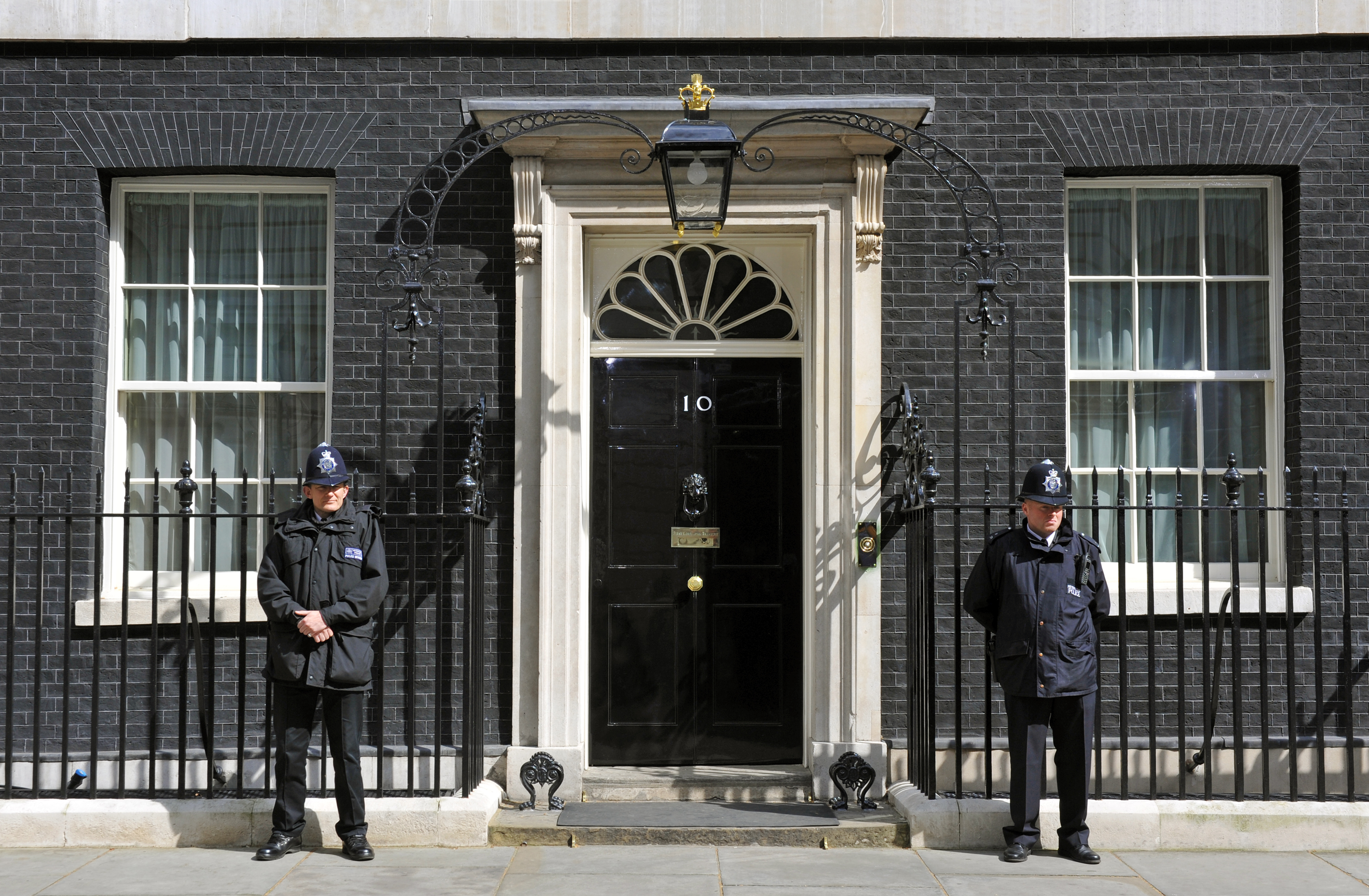 Two police officers guarding 10 Downing street
