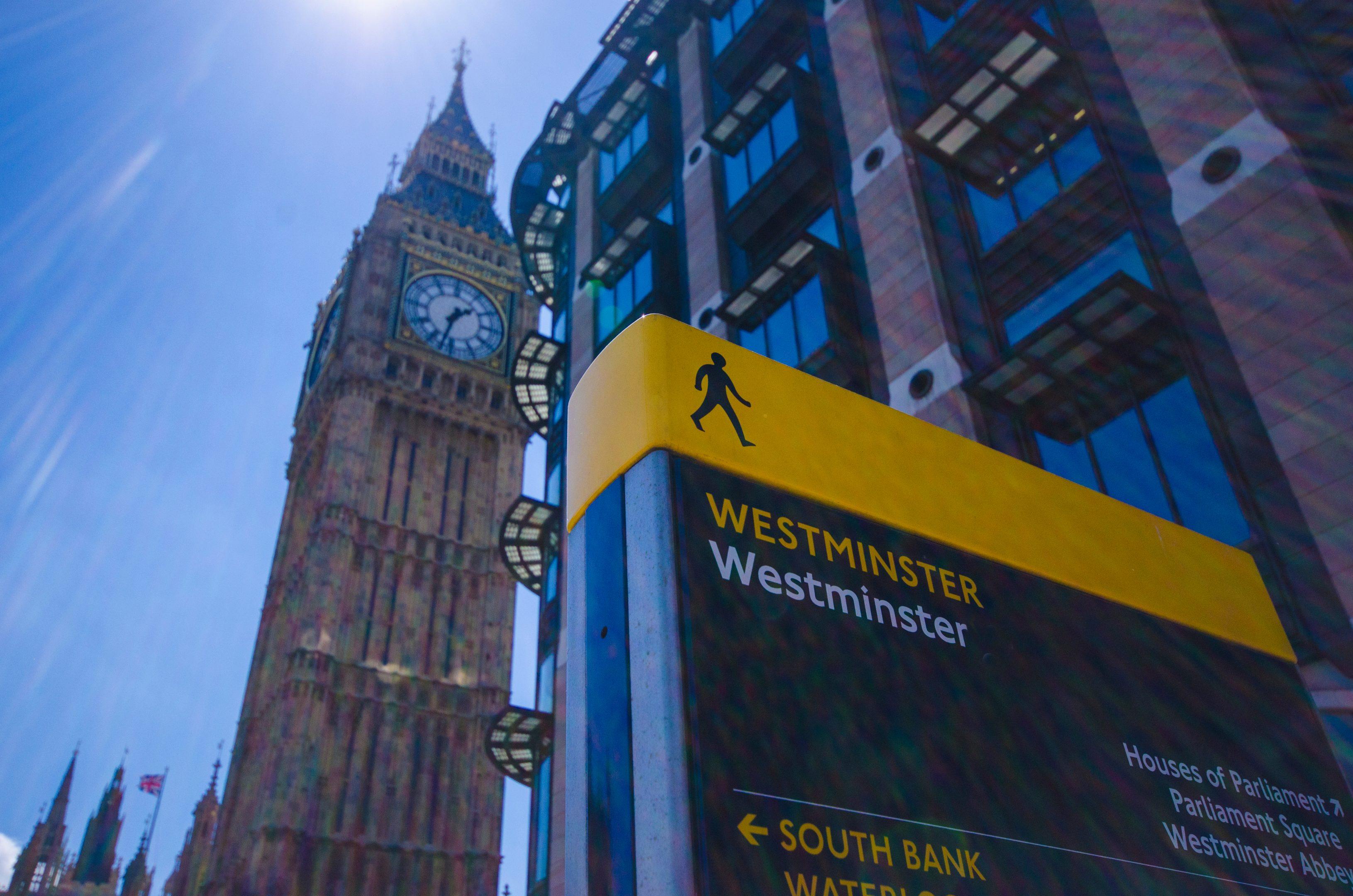 Big Ben/Elisabeth Tower, Portcullis House, and Westminster sign