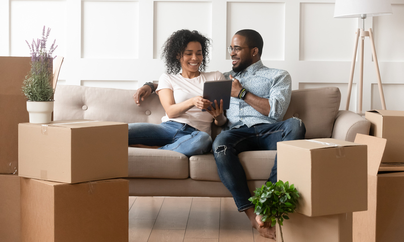 couple in new home with cardboard boxes