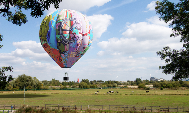 Hot air balloon flying over Thamesmead fields